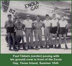 Paul Tibbets (center) posing with his ground crew in front of the Enola Gay, Tinian Island, Summer 1945.