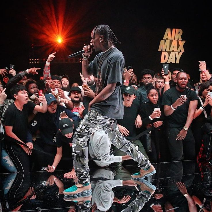 Travis Scott Performs At Air Max Day Wearing Nine Inch Nails T-Shirt, Vetements Camo Pants And Nike X Marc Newson Sneakers