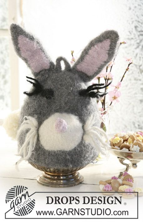 """Felted DROPS egg warmer/tea warmer knitted as funny Easter bunny in """"Eskimo""""."""