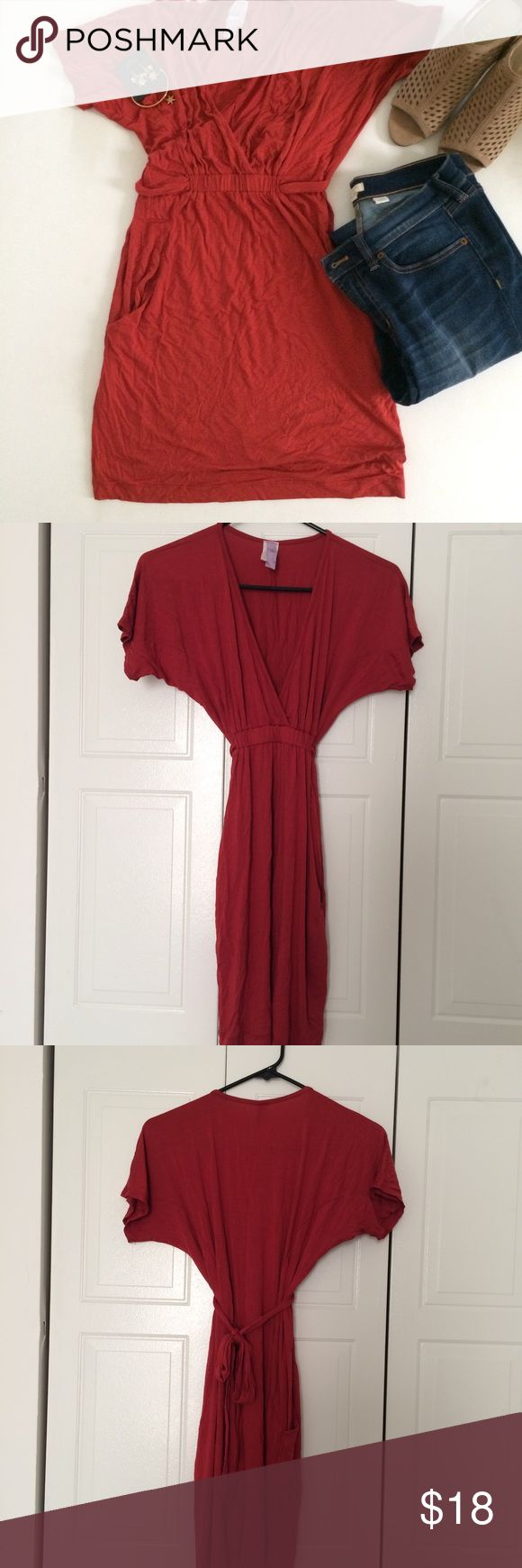 """Dolman sleeved, Deep V Tunic EUC. Very cute tunic for summer and fall. Great burnt orange color. From Francesca's Collection. Ties back to cinch the waste and has pockets. It has a deep v-neck neck line. You may need a cami. It's a little too short to be a dress on me, I'm 5'5"""". It just covers my rear end. I've worn it with leggings or skinny jeans. Only worn twice. Francesca's Collections Tops Tunics"""