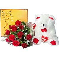 Chocolaty Celebration - Add a touch of Smile with this perfect gift combination of 12 Red Rose bunch, Cadbury Celebration Pack and a cute Teddy Bear.