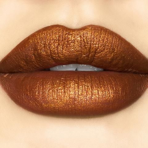 Pumpkin Spice Liquid Lip Color By Sugarpill Cosmetics - We're so obsessed with all things pumpkin spice, we couldn't resist giving our Pumpkin Spice eyeshadow a friend - a sparkling metallic liquid lip color! Indulge yourself in this pumpkin spice-scented, rustic copper pearl with warm golden reflects. Our creamy, mousse-like formula is ultra-pigmented, non-drying, and super long-lasting!