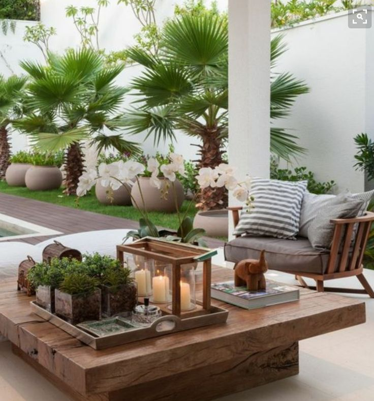 Summer style!! Veranda terrace deck patio -- elegant outdoor lounge area!! LOVE the large wood coffee table!! DIY!!