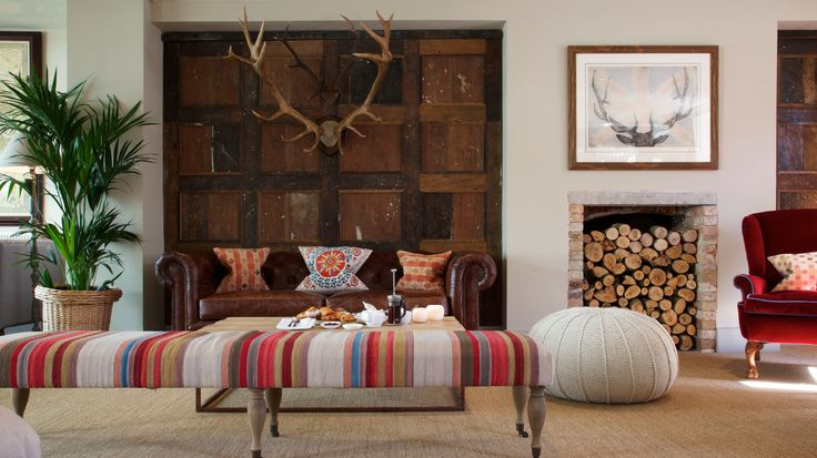 Furnished in the style of a rustic hunting lodge.