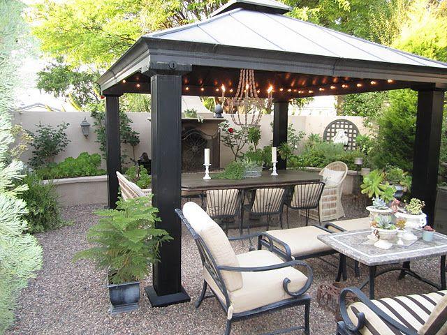Love the gravel patio, the metal gazebo, the lights...