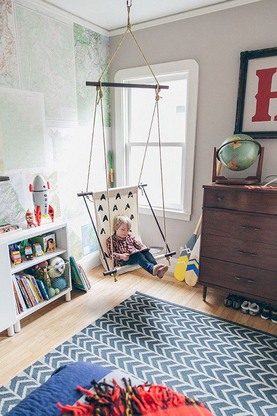 A modern boys room with a hanging chair for after school reading