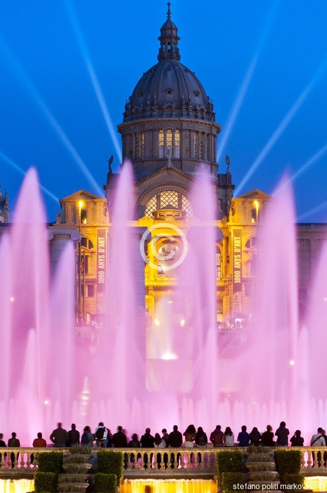 This spectacular, pink illuminated water feature is the Font Magica de Montjuic in Barcelona, Spain.