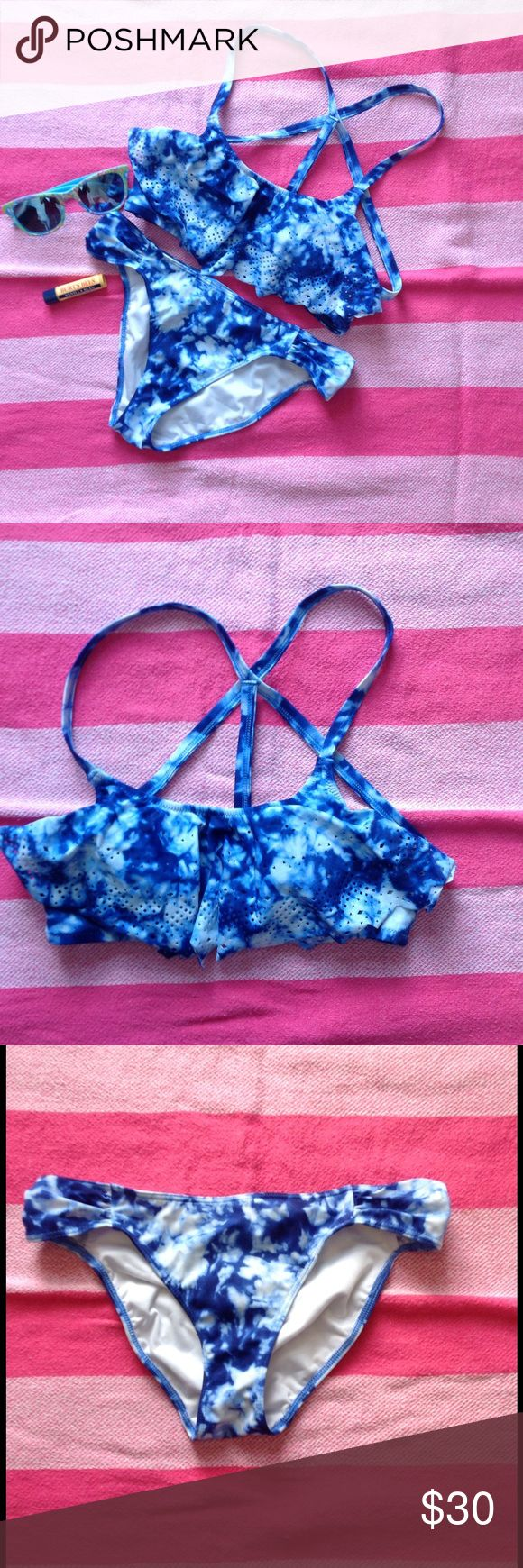 VS Pink flounce bikini Blue tie-dye flounce bikini. Strappy back bikini top with ruched-side bikini bottoms. Tag has been cut out of top but size is comparable to bottoms which are XS. PINK Victoria's Secret Swim Bikinis