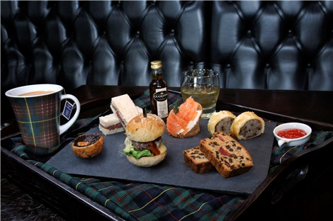 Cameron House partnered with Glengoyne Distillery on Loch Lomond to offer a Whisky Tea - a fine menu of Rare Roast Beef and Arran Mustard Sandwiches, Haggis Sausage Roll, John Ross Smoked Salmon Roll, Mini Aberdeen Angus Burger, Black Pudding Scotch Egg, Glengoyne Whisky Fruit Cake, a 10 year old Glengoyne Whisky Miniature and a mug of tea served on a slate spread.:  Visit Britain