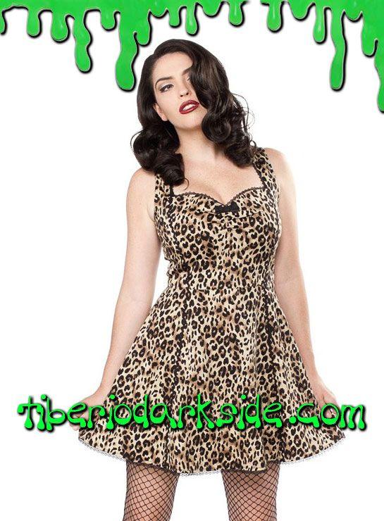 Vestido pin up estampado de leopardo con escote fruncido en forma de corazón, mini lazo y ribete negro. Falda con ligero vuelo. Materiales: 95% algodón, 5% spandex. Marca: Sourpuss.  COLOR: NATURAL TALLAS: S, M, L  S - 82 cm pecho (ES talla 36, MEX talla 26, UK talla 8) M - 88 cm pecho (ES talla 38, MEX talla 28, UK talla 10) L - 94 cm pecho (ES talla 40, MEX talla 30, UK talla 12)
