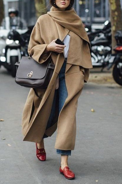 A pop of red flats adds color to this camel colored coat! Super chic.. and we're loving it
