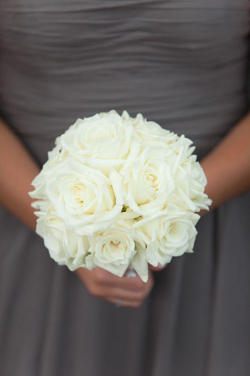 Beautiful ivory bridesmaid bouquet for Chicago wedding at Crystal Gardens with photos by Miller + Miller Photography | junebugweddings.com