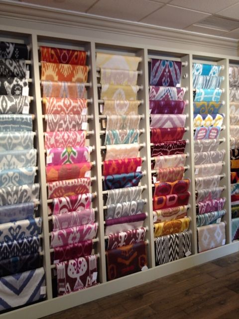 Great Idea to hang fabrics in store.  http://www.grnyrenovation.com/commercial-remodeling-nyc.php