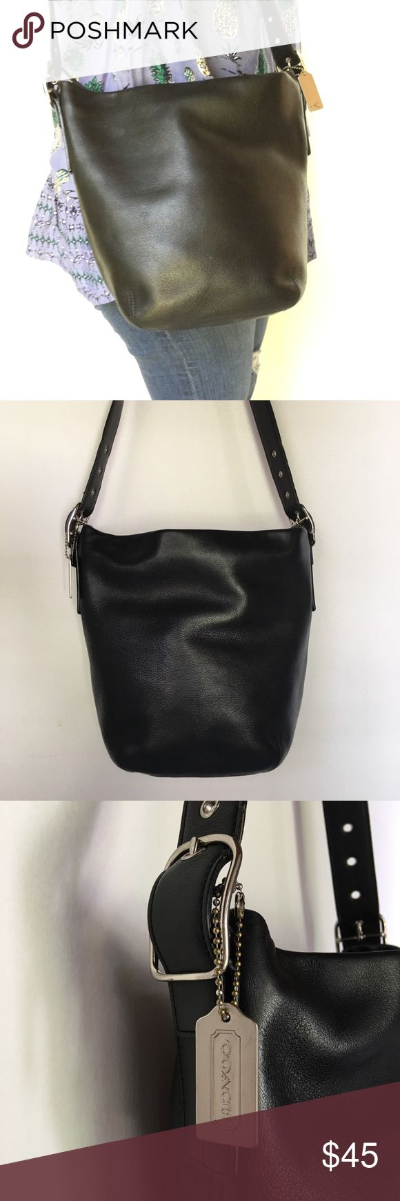 "Coach Legacy Black Leather Bucket Bag Medium Pre-owned authentic Coach Legacy Black Leather Bucket Bag Medium. Bag is 11x10"" inches. Adjustable Strap is 37.5"" inches. Bag is in great condition, inner lining has some minimal wear. Please look at pictures for better reference. Happy Shopping! Coach Bags Shoulder Bags"