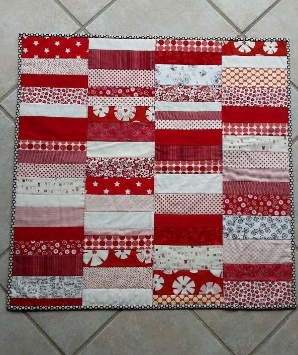 Baby quilt in red. June 2015.