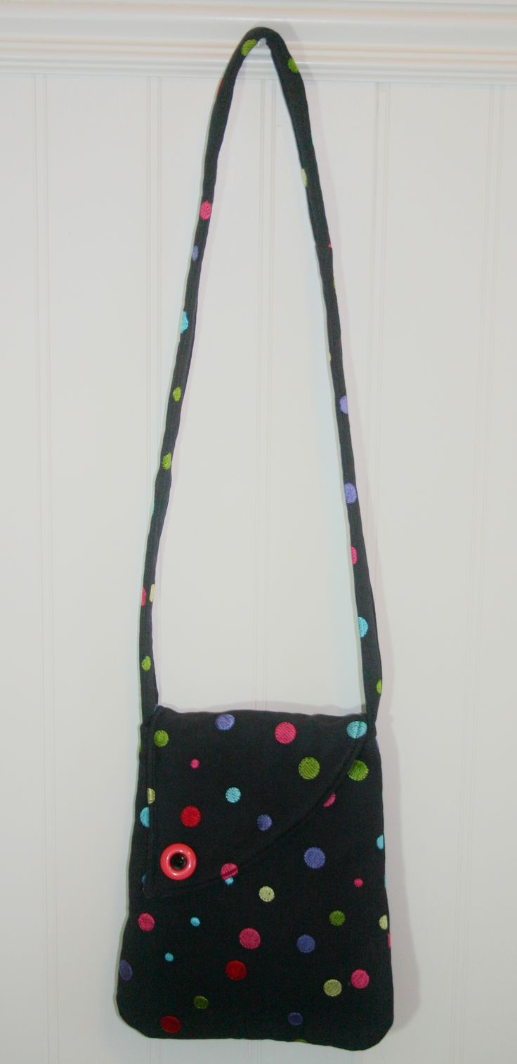 Black fabric with embroidered poka dots make this purse so fun.