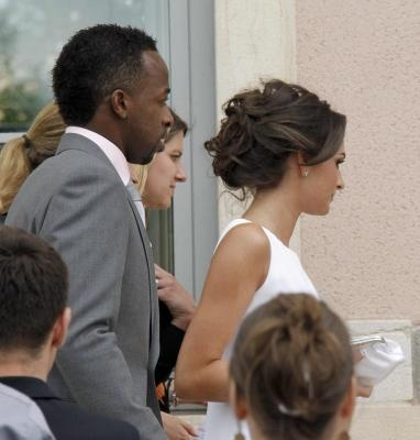 French soccer player Sidney Govou walks with Clemence