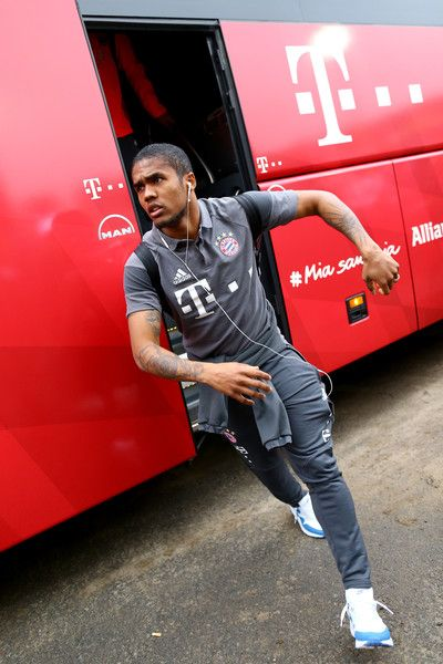 Arturo Vidal Photos Photos - Douglas Costa of Bayern walks out of the bus prior to the Bundesliga match between SV Darmstadt 98 and Bayern Muenchen at Stadion am Boellenfalltor on December 18, 2016 in Darmstadt, Germany. - SV Darmstadt 98 v Bayern Muenchen - Bundesliga