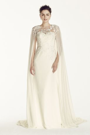 This dress has that regal feel for your fairytale day!  Crepe sheath with illusion neckline and exquisite beaded lace on bodice.  Features floor length chiffon cape with beaded lace detail on shoulders.  Sizes 0-14. Available in Ivory in select stores.  Fully lined. Back buttons. Imported. Dry clean only.  To preserve your wedding dreams, try our Wedding Gown Preservation Kit.