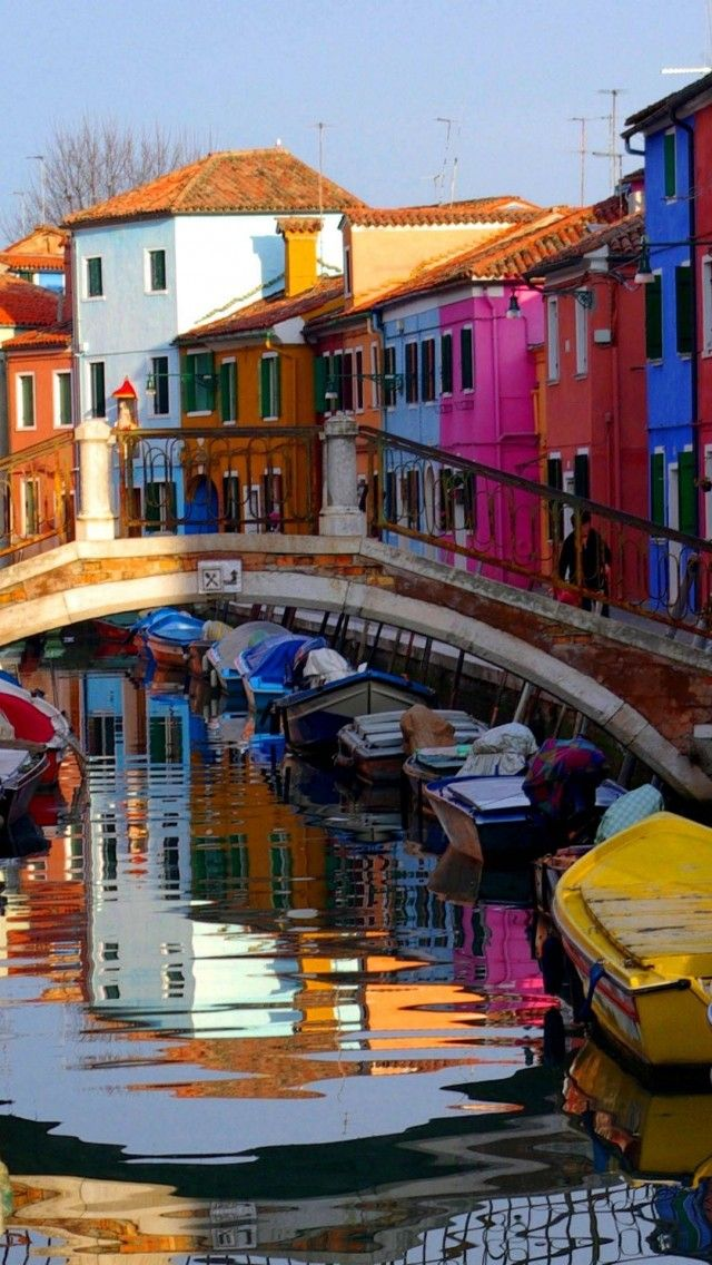 Colorful reflections in Burano, Veneto, Italy  Burano is gorgeous with its rainbow-colored dwellings. I fell in love instantly! Sometimes I fantasize about living there. I wonder what it would be like to actually live there?!