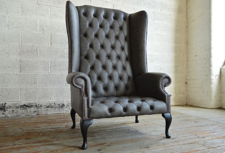 Modern British handmade deep buttoned Grande Boss Chesterfield Wing Chair, shown in grey leather. Oversized 6ft tall high back chair style. | Abode Sofas
