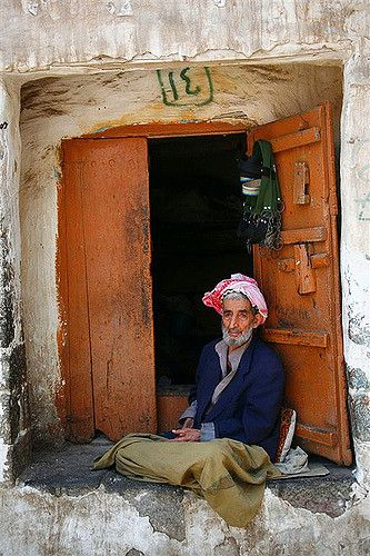 Old man sitting cross legged on the edge of the window - Y…   Flickr