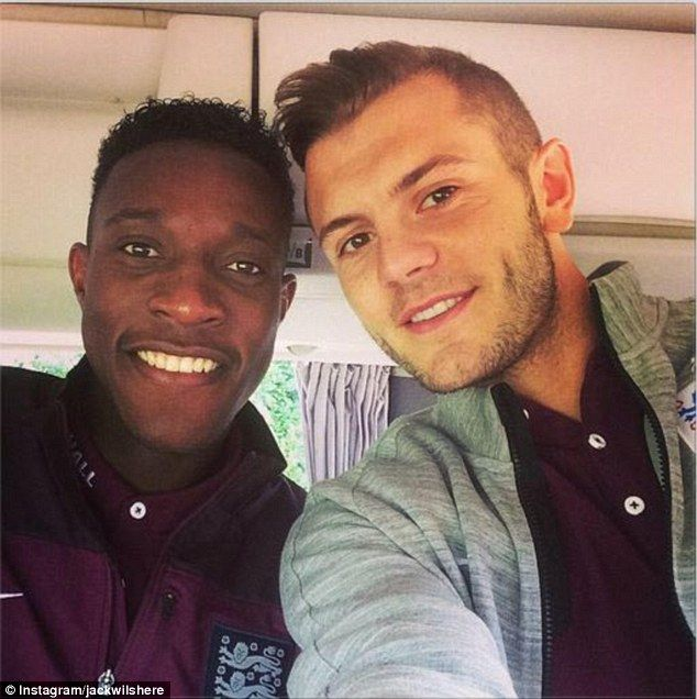 Happy: Jack Wilshere (right) welcomes Arsenal new boy Danny Welbeck to the team with an In...