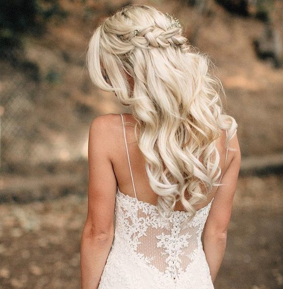 Loose wavy curls and a boho braid + some sweet sprigs of baby's breath = the perfect 'do for a bride or her 'maids,wedding hair down ideas