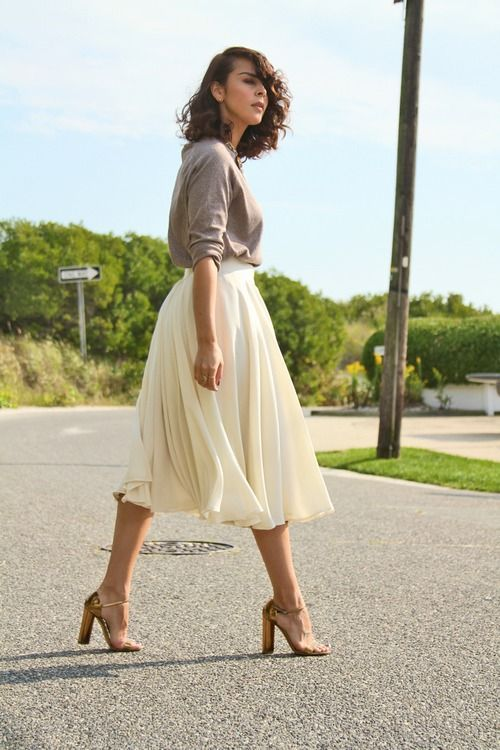 Classic elegant skirt with a casual top is a beautiful contrast and makes this outfit look effortless