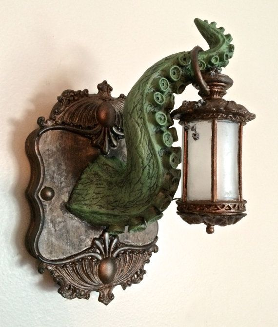 Sculpted tentacle holding an ornate Victorian lantern mounted on a resin plaque. LED illuminates the lantern with a push button, battery…