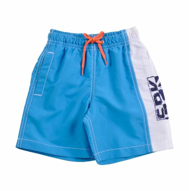 """Traje de Baño tipo """"BoardShort"""" para bebe niño confeccionado en poliester 100%, en color azul turquesa con un lado en color blanco, con estampado de EPK vertical en azul oscuro y blanco. Cintura con pretina elastizada, con un cordón que se enlaza al frente. En la parte de atrás de la pretina, tiene calcomanía de EPK en color blanco con detalle en anaranjad"""