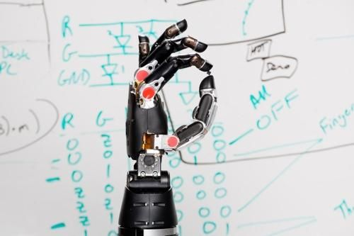 DARPA is working on a new kind of prosthetic that will let amputees feel the sensation of touch again.