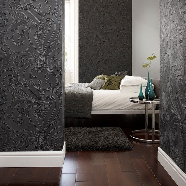 This graphic shape is combined with luscious metallic for an industrial look. This Graham and Brown ornamental design will create that exclusive statement you're looking for. The raised swirls in this design are line drawn with glitter for a soft finish and will add a beautiful effect to your home. The wallpaper is paste the paper, meaning its more manoeuvrable and therefore less likely to have gaps, creating that chic modish look.