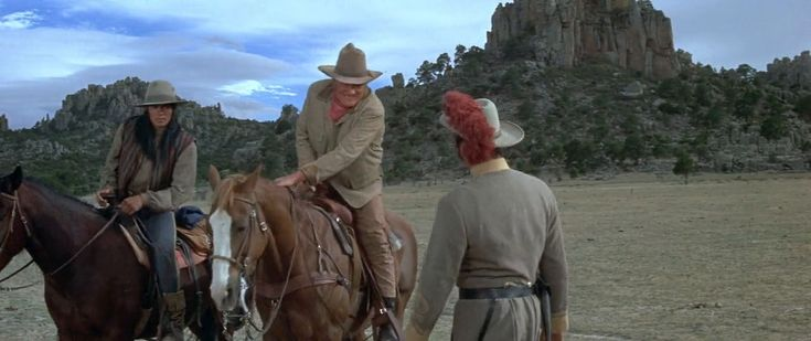 John Wayne, Rock Hudson, and Roman Gabriel in The Undefeated (1969)