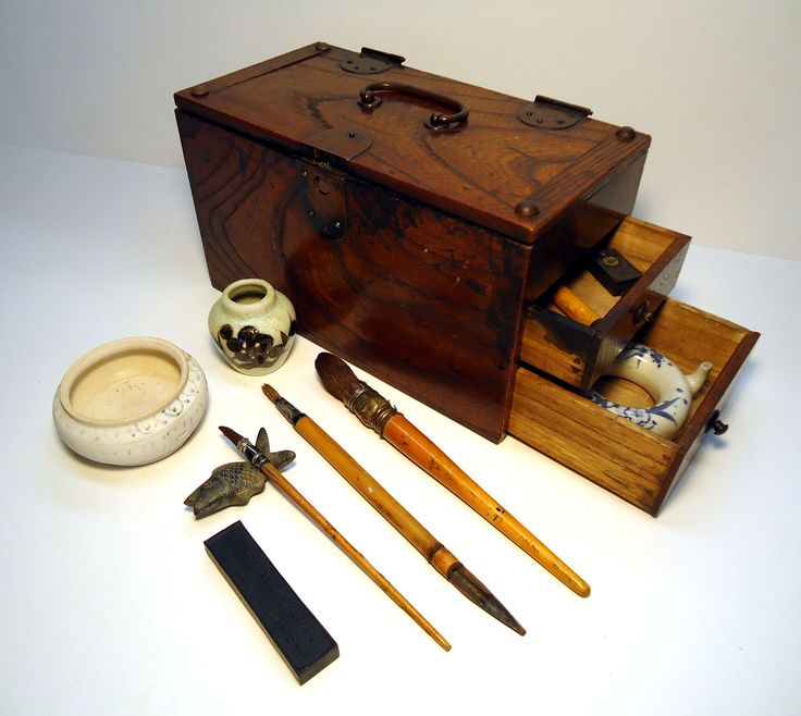 A Japanes box around 1860's  This box was used both by Artists and Accountants.  It often held rolls of rice paper an ink stick and a brush, This  was empty when i got it and I have added tools I often use to paint.