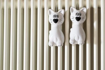 Two. Humidifier on a radiator. Glass figurine cat