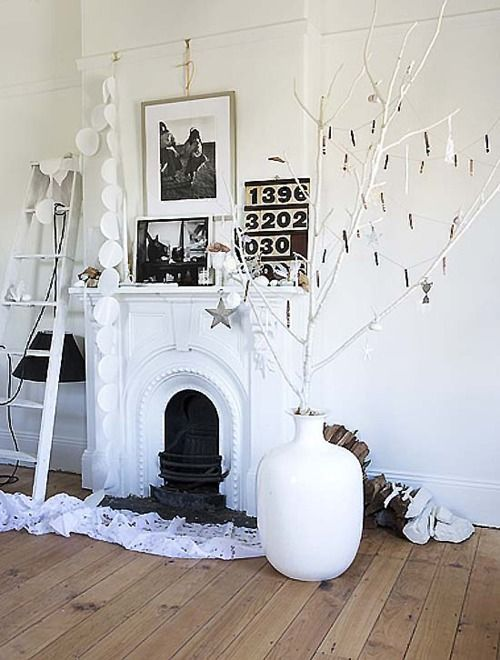 beautiful fireplace vignette and in my favourite palette...white!