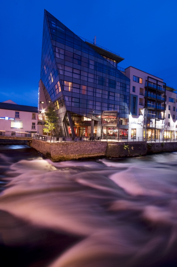 The distinctive Glasshouse Hotel looks out over the Garavogue river as it rushes past, down to the harbour.