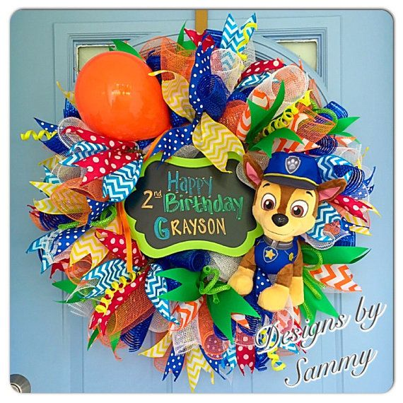 Birthday Custom Decomesh Wreath, Paw Patrol Birthday Decor, Birthday Party Decor, Custom Chalkboard Wreath  **comes with 1 removable 15 stuffed character to keep after youre done with the wreath, or leave in and use in playroom or childs room as decor!!!!**  This wreath can be customized to fit any party theme and can include removable stuffed animals, chalkboard or other items found in your themes decor! It is made on a 24 frame and fills out to be a 27 wreath with 8 depth! Its stocked full…