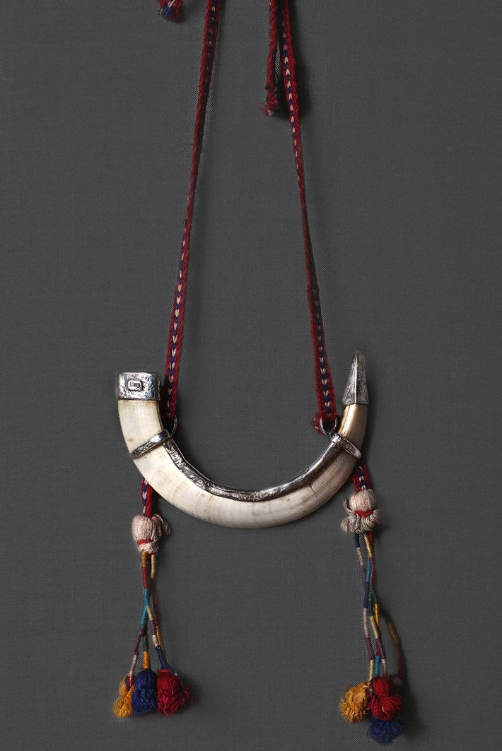 Ewa Jewelry Tusk and Antique Timor Fabric