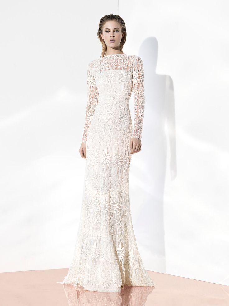 [vc_row][vc_column][vc_column_text]Эффектное облегающее свадебное платье на чехле линии «Glint Couture».  Эксклюзивное кружево с крупным симметричным рисунком в стиле «арт-деко» сплошь покрывает грациозный силуэт с высоким прямым вырезом горловины и длинными рукавами.  Талия акцентирована узким пояском.  Свадебные платья Yolan Crisэксклюзивно представлены в салоне Виктория  Примерка платьев Yolan Cris -платная[/vc_column_text][/vc_column][/vc_row]
