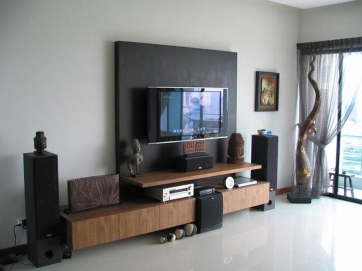 Spectacular Tv Wall Mounting Idea With White Wall With Black Wall Accent And Brown Tv Cabinet
