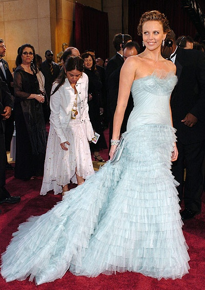 In 2005 fashion critics unanimously choose Charlize Theron's pale blue Christian Dior gown as the big winner on the Oscar red carpet. John Galliano's satin organza and silk couture gown was covered in edges and ruffles of tulle giving it a truly ethereal effect that was so hot that year. Topping off her red carpet look she wore Bulgari jewels with a clutch by Lana Marks.