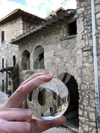 Historic stone house and glass ball view, Castel Trosino, Marche region, Italy