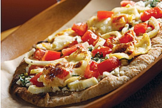 Heirloom tomatoes and ricotta cheese top these grilled pizzas
