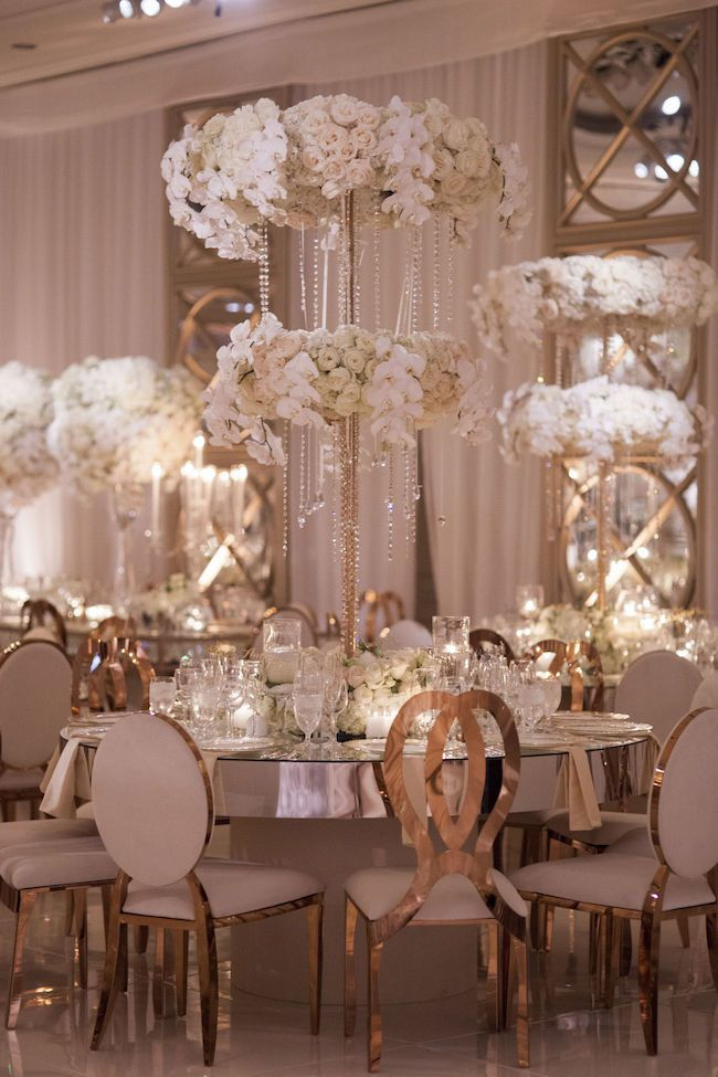 Gorgeous White Wedding for Details, Details Wedding and Event Production at the Four Seasons, Los Angeles. We provided the Lush Sheer Drapery and Chandeliers for the picture perfect ceremony design. The Four Seasons Los Angeles has a lovely fountain on property. The ceremony tent was strategically placed next to the fountain. We draped the exterior and added our custom signature valence.