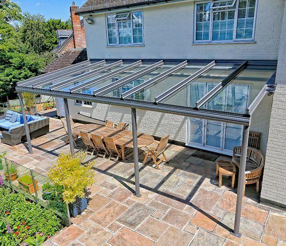 A glass veranda can create the perfect outdoor entertainment area