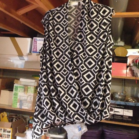 Sleeveless black and white shirt Sleeveless shirt. Drapes to one side as shown. New York & Company Tops
