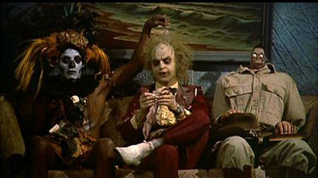 BEETLEJUICE!!!!!!!!!!!! this movie i love it used to scare the hell out of me when i was a kid but i love it now!!