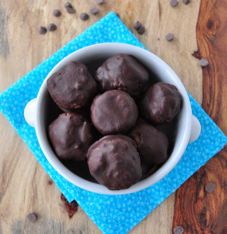 Baked Chocolate Covered Pumpkin Donuts made with whole grains and no refined sugars.